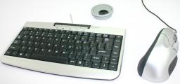 Mini keyboard with grip mouse and desk grommet